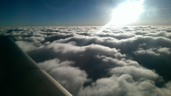 plane above the clouds